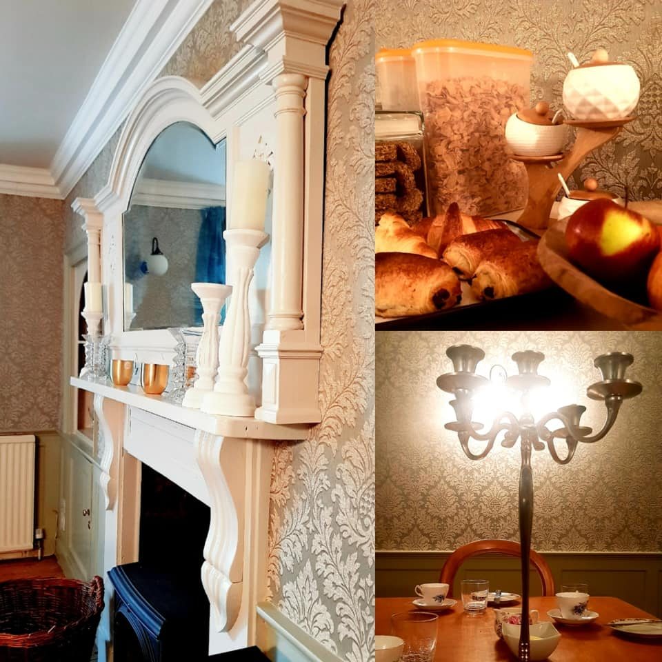 An elegant and luxurious room in Treglisson guest house, with large fireplace, georgian damask wallpaper and breakfast with croissants, pan au chocolate, cereal and fruit